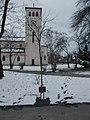 József Bátki memorial tree and Catholic church, 2018 Pestújhely.jpg