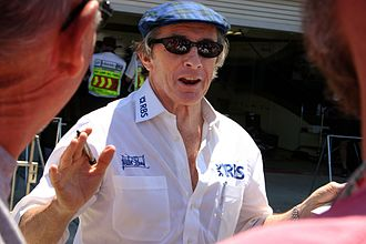 Jackie Stewart - Stewart greets fans in the pit lane at the 2005 United States Grand Prix at Indianapolis