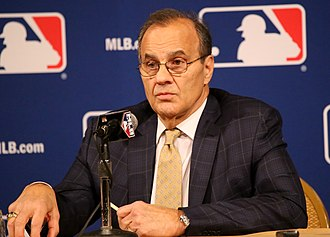 Joe Torre - Torre talks to reporters at the 2015 Winter Meetings