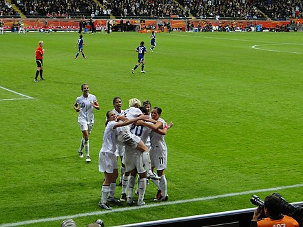 Rapinoe (top) celebrates with her teammates after the United States scores a goal during the 2011 FIFA Women's World Cup final Jogadoras dos Estados Unidos comemoram gol (DSC01163).jpg