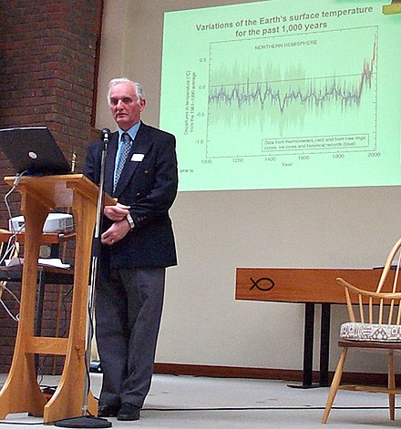 IPCC WG1 Co-chair Sir John T. Houghton showing the IPCC fig. 2.20 hockey stick graph at a climate conference in 2005 John Houghton High Wycombe 20050226.jpg