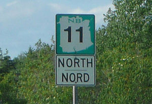 Reassurance marker - Reassurance markers on New Brunswick's provincial highways feature bilingual (English/French) direction tabs.