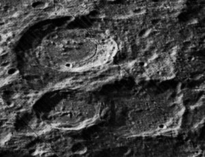 Milankovič (lunar crater) - Oblique view of Karpinskiy (upper left), Ricco (lower left), and Milankovič (lower right), from Lunar Orbiter 5