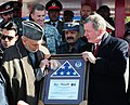 Karzai is presented a certificate of recognition.jpg