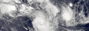 Cyclone Katrina - Three simultaneous cyclones on January 7: Katrina (left), Susan (center) and Ron (right)