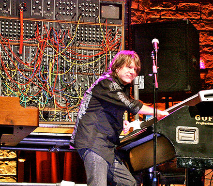 """I took to riding the L100 like a bucking bronco. It weighs 350 lb; when it's on top of you, you need the adrenalin rush you get onstage to chuck it around."" Keith Emerson Keith Emerson & Moog 15May10.jpg"