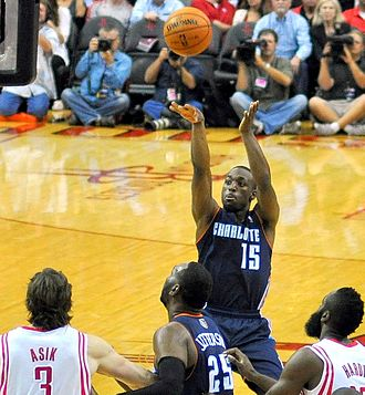 Kemba Walker - Walker shoots during a game against the Houston Rockets, October 2013.