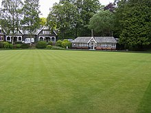 Bowling green with Victorian building at the rear