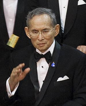 Thailand's King Bhumibol Adulyadej waves to we...