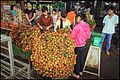 Ladies selling rambutan fruit (14424079900).jpg