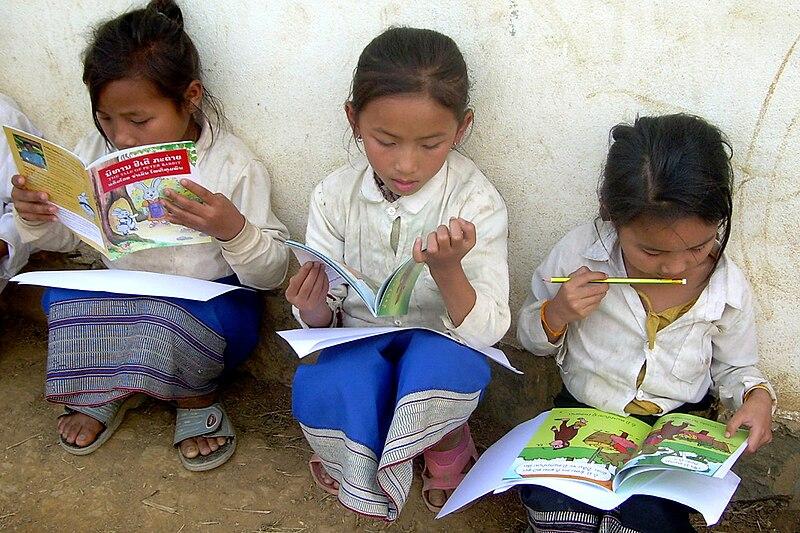 Lao schoolgirls reading books.jpg
