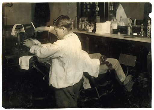 Lewis Hine, Frank De Natale, 12-year old barber, Boston, 1917