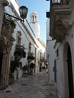 Locorotondo street and clock tower.jpg