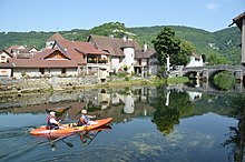 Lovely reflections of the houses of Vuillafans with kajak tourists - panoramio.jpg