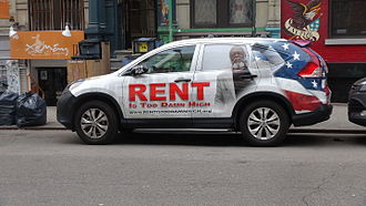 8th Street and St. Mark's Place - Rent Is Too Damn High Party car parked on St Marks Place, where founder Jimmy McMillan lived until 2015