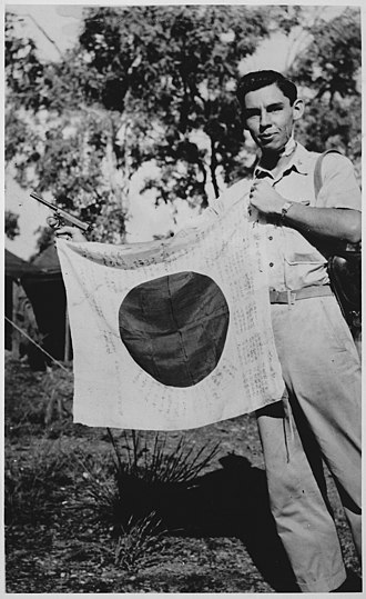 Native Americans and World War II - Image: Lt. Woody J. Cochran holding a Japanese flag, New Guinea, 04 01 1943 NARA 519155