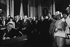 English: President Lyndon B. Johnson signs the...