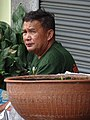 Man with Urn - Old Town - Lampang - Thailand (34352556544).jpg