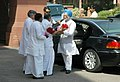 Manmohan Singh being welcomed by the Union Minister of Overseas Indian Affairs and Parliamentary Affairs, Shri Vayalar Ravi on his arrival at Parliament House to attend the 13th session of 14th Lok Sabha, in New Delhi (1).jpg