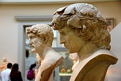 Marble busts of Hadrian (left, 117-138 CE, probably from Rome) and Antinous (right, 130-138 CE, from Rome). Antinous was Hadrian's lover. He met Hadrian in 120s CE and died in the Nile, Egypt, in 130 CE. The British Museum, London.jpg