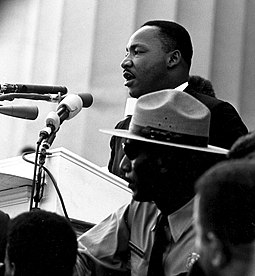 "King gave his most famous speech, ""I Have a Dream"", before the Lincoln Memorial during the 1963 March on Washington for Jobs and Freedom. Martin Luther King - March on Washington.jpg"
