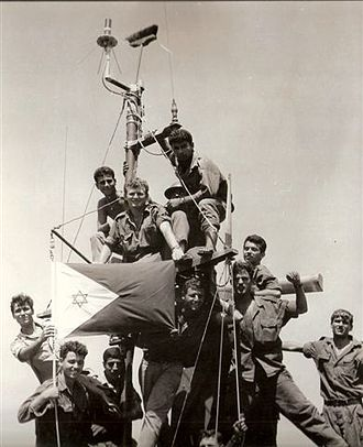 Battle of Rumani Coast - Israeli MTB crew raise the broom on the topmast as a traditional maritime sign of victory.