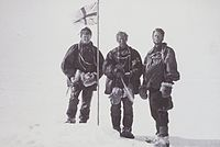 Mackay, David and Mawson raise the flag at the Magnetic South Pole on 16 January 1909