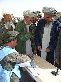 Men of northern Afghanistan preparing to vote in 2004.jpg