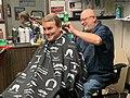 Michael Bennet getting a haircut.jpg