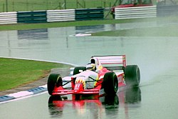 Michele Alboreto - Lola T93-30 during practice for the 1993 British Grand Prix (33557339751).jpg