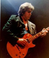 Mick Taylor onstage The Lucky (cropped).png