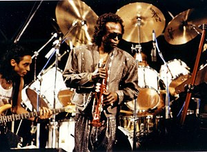 Jazz improvisation - Trumpeter Miles Davis in 1989. Davis was one of the key innovators of jazz fusion, a genre of music which developed in the late 1960s by blending the improvised solos of jazz with the rhythms and amplified electric instruments of rock music.