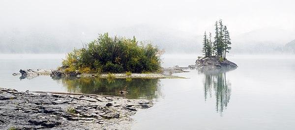 Lake Minnnewanka in a cold misty morning in autumn