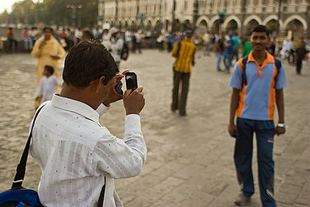 Mumbai guy taking photo of friend November 2011 -6-4.jpg