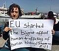 NGO activist Idil Gökber protests deportations of migrants from Greece back to Turkey, April 4, 2016.jpg