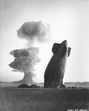 A blimp is felled by the shockwave from a nuclear test at the Nevada Test Site, 1957.