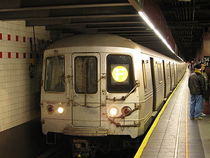 R46 F train, led by car 6028, at Herald Square...
