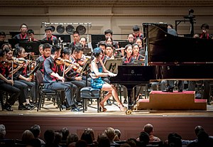 National Youth Orchestra of China - The National Youth Orchestra of China performing with Yuja Wang and Ludovic Morlot (hidden) at Carnegie Hall on July 22, 2017.