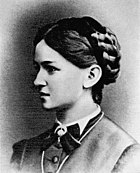 Side view of a young woman with dark hair braided up on her head