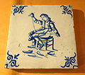 Netherlands tile depicting shoemaker stitching footware, 2 of 2, c. 1630, ceramic - Bata Shoe Museum - DSC00293.JPG