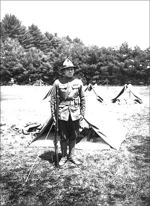 New Hampshire State Guard - An early 20th century New Hampshire State Guard soldier stands at attention by a tent in Keene, New Hampshire.