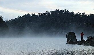 Lake Waikaremoana - Fisherman on the bank of the lake