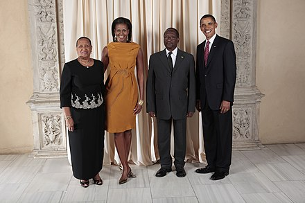 President Barack Obama and First Lady Michelle Obama pose for a photo during a reception at the Metropolitan Museum in New York with Nicholas J O Liverpool, President of the Commonwealth of Dominica, and his wife, Mrs. Verna Liverpool. Nicholas J O Liverpool with Obamas.jpg