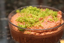 A bean dip prepared with kidney beans, garnished with lime zest
