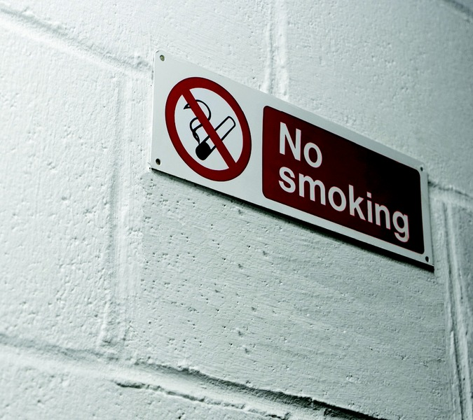 File:No smoking sign on wall.tiff