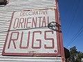 Oak Leonidas Oriental Rugs Sign.jpg