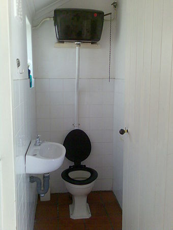 An elevated cistern produces a high-pressure flush using hydrostatic pressure Old toilet with elevated cistern and chain.jpg