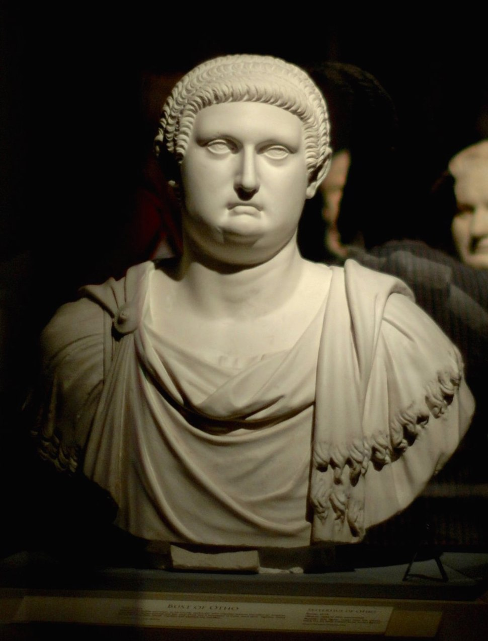 Bust depicting a man with a full head of hair wearing a Roman tunic