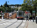 Outbound train at Duboce and Noe, April 2018.JPG