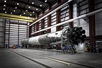 PROSpaceX Photos Siguiendo Falcon 9 first stage in hangar.jpg